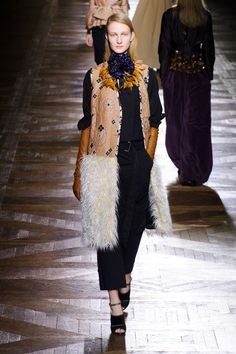 Van Noten is relentless in his dedication to mixing colors, patterns and, for Fall, high and low, showing an elegant hodgepodge of cargos and utility canvases mixed with jacquards and furs. It's not the newest blend of ideas, but in van Noten's hands, it's the best.   - HarpersBAZAAR.com