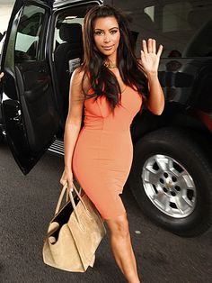 Kim Kardashian flaunts her famous figure in a body-hugging minidress while promoting the family's Kardashian Kollection for Sears Friday in Hoffman Estates, Ill