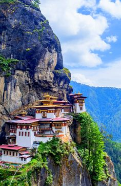 Taktsang Monastery, aka Tiger's Nest is located on the side of a cliff in the Paro Valley in Bhutan. Incredibly beautiful, this incredible building has seen two renovations in 1958 and 2005 Places Around The World, Travel Around The World, Around The Worlds, Amazing Destinations, Travel Destinations, Wonderful Places, Beautiful Places, Rivers And Roads, Fantasy Places
