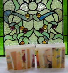 Stained Glass - I got the inspiration for this soap from a couple of pieces of stained glass artwork I have. While it is not as ornate as a church window it is still beautiful and almost appears as if there is light shining through.  Actually it's made from some slices from cured soaps that were ...