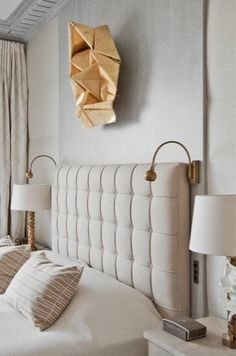 Tufted headboard with art above! So chic and classy  Jean Louis Deniot headboard, sconces and table lamps