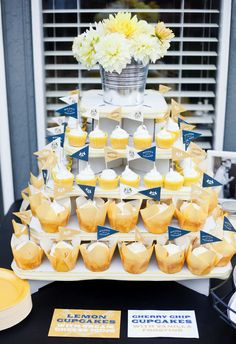 Mini cupcakes with flags and ribbon around the cake stands! Love the flowers on top too!