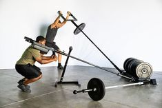 Two in One! A convenient free standing landmine exercise station and a bumper plate storage rack. (Renegade Mountable (landmine) not included, sold separately. Crossfit Garage Gym, Home Gym Garage, At Home Gym, Best Cardio Workout, Gym Workouts, At Home Workouts, Diy Gym Equipment, No Equipment Workout, Bodybuilder