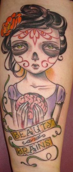 I would change her face, and the fact that shes holding her brain... i really like the idea of a beauty and brains tattoo