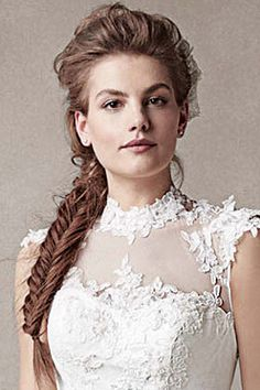 A side-swept, textured fishtail braid has a rustic-chic appeal.