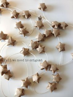 Rustic stars on a string. by allweneedisorigami on Etsy, $16.00