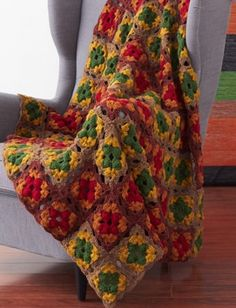 Hearty Harvest Afghan - Just imagine curling up under this crochet afghan after Thanksgiving dinner!