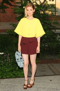 Spotted in Coach: Kate Mara with the Coach FW14 Rhyder Zip Messenger Bag in Blue at the 2014 Summer Party on the Highline Presented by Coach (Photo credit: BFA)