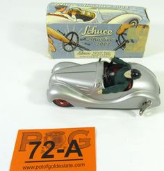 Lot 72a in the special Saturday 9.21.13 online & live auction! Vintage Schuco-Akustico model 2002 wind up model toy car is in excellent condition! Made in West Germany, silver painted exterior, with red painted seats and hub caps, finely detailed lithographed dash & floorboard. Features wind up horn-clockwork & wind up motor- clockwork, includes original miniature driver, original wind up key, functioning steering wheel, horn, motor, hand break, wheels, & original box. #German #Play…