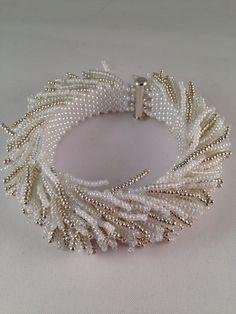 Beaded sea urchin bracelet by XxxWithyouinmindxxX on Etsy