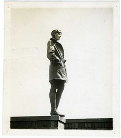 Portrait of Amelia Earhart, in a heroic / monumental pose. Copyright by her husband, George Putnam  [What a fabulous pair of boots, too!]