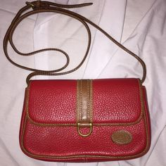 1980's Vintage Liz Claiborne Pebbled Purse From my personal collection. I have many vintage items so check other listings :)  NEW WITHOUT TAGS  this is a 1980's All leather pebbled purse. color is dark red or burgundy. Small sized purse with removable strap so it can be carried as a clutch. Has brown leather trimming with a small logo patch on the corner. Measures 8 inches X 5.5inches X 2.25 inches. The adjustable cross body strap measures 44 inches and expands another 3 inches. Strap is 1/2…
