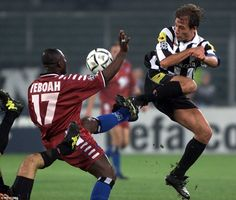 Hamburg striker Tony Yeboah challenges Conte for the ball during a Champions League group game in October 2000 in Turin