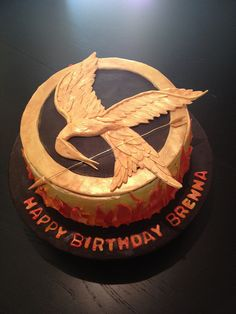 Hunger Games Birthday Cake for Brenna.  Gumpaste Mockingjay, fondant flames and buttercream icing.
