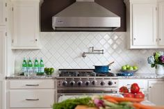 Arabesque tile...stunning!   Mel's comment:  They are beautiful ... but what I like most is the almost unnoticeable faucet above the stove.  I'm assuming it's probably instant hot water ... how awesome is that?!!