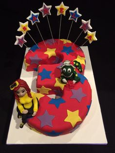 """It's a rosey bowtiful day"" Wiggles cake with Dorothy the dinosaur and Emma (yellow wiggle) pic 1"