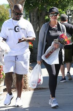 Happy together:  Jenner, 59, smiled as she led her much younger boyfriend Corey Gamble - w...