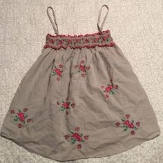 """Favorite! Grey top with Roses I love this top. In great condition. Adjustable straps, embroidered rose detail on a pretty grey base. """"Heritage 1981"""" from Forever21.   Bundle to save 20% Forever 21 Tops Tank Tops"""