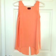 Sleeveless Orange Top Sleeveless orange sorbet colored hi-low top with slit in back. Worn only once. Size XS by Mossimo. Mossimo Supply Co. Tops