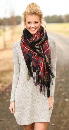 Sweater dress   plaid blanket scarf. Winter fashion trends.