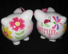 """Our Large White Ceramic Pig Bank! This adorable round piggy with its big ears, four legs, tail and snout has been our most popular item year after year. It has four scratch-resistant pads on its feet and a rubber stopper on the bottom. Definitely a """"must have"""" item. I can match your bedding, room decor or come up with something special just for you. This item is custom made especially for you upon order. Dimensions: 8 x 6 x 7   orders do take 3-4 weeks plus shipping... if you need an order…"""