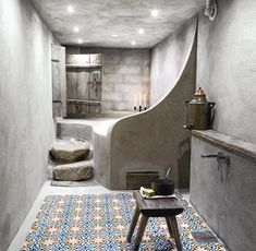 Home Decorating Ideas Bathroom Concrete wall, concrete bath, Moroccan tiles, stools, ceiling lighting The bathroom is … http://www.awesomehome.org/home-decorating-ideas-bathroom-concrete-wall-concrete-bath-moroccan-tiles-stools-ceiling-lighting-the-bathroom-is/