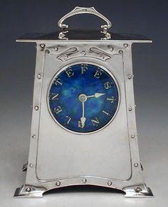 Liberty & Co. A Cymric silver clock.