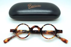 Frame Holland Hand Made Preciosa 703 Acrylic Small Round Blonde Tortoiseshell Effect finish Glasses - The Old Glasses Shop Small Round Glasses, Round Specs, American Eyewear, Design Retro, Vision Glasses, Glasses Shop, Round Eyeglasses, Prescription Lenses, Glasses Frames