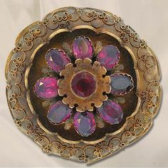 Victorian period golden etruscan revival pin set with back foiled garnets.