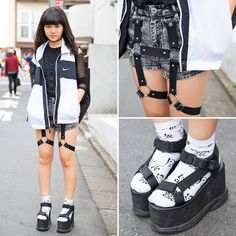 Japanese high school student Ayuka on the street in Harajuku wearing a Nike vest over a Fig & Viper top, Glad News harness shorts, and Spinns platform sandal with socks.