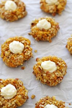 Carrot cake thumbprint cookies -- delicious carrot cake-flavored cookies filled with a tangy, creamy, jam-swirled frosting. Carrot Cake Cookies, Soft Sugar Cookies, Healthy Dessert Recipes, Cookie Recipes, Delicious Desserts, Mini Desserts, Just Desserts, Spring Desserts, Banana Treats
