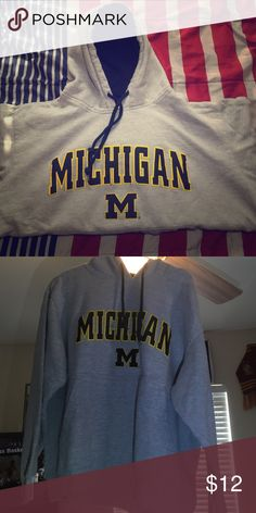 Michigan sweater with hood -made exclusively for foot locker by team edition apparel -great to wear in the winter and fall -open to offers and counter offers Sweaters