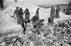 Female SS soldiers filling mass grave w. corpses while under guard by British soldiers at the Bergen Belsen concentration camp