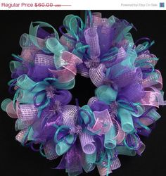 Put this wreath on your front door and keep it up for weeks! This really simple purple, lavender, turquoise, pink wreath will look awesome on your