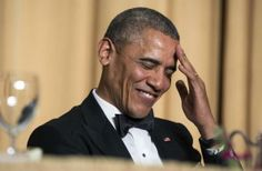 U.S. President Barack Obama rubs his head as he laughs at a joke during the White House Correspondents' Association Dinner in Washington May 3, 2014. REUTERS/Joshua Roberts