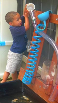 "TreeHouse Preschool: Add pipes to funnels on the water wall ("",)"