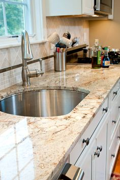 Perimeter counters and island in Typhoon Bordeaux granite with Eased edges.