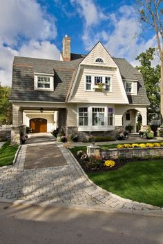 What a darling house...you can't go wrong with window boxes and a garage tucked in the back.