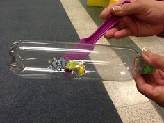 Fun with magnets in Miss Margie's toddler classroom.  Create this activity at home using a plastic bottle, stickers (here, Miss Margie used bug stickers), brads and a magnet stick.
