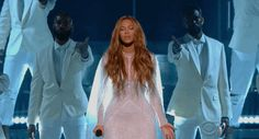 Beyonce reaching out during her performance