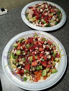 My version of camp food over Memorial Day.  Romaine lettuce, tomatoes, apple, avocado, grapes, carrots, dates, cranberries, strawberries, slivered almonds and Ahi Tuna on one of them.  Ground Pepper and Ranch Non-Fat salad dressing made these the envy of the other campers.  These were individual salads and YES, we ate all of it!  ~T.