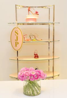 Pink ranunculus blooms + SJP shoes.