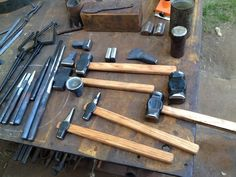 via shopdweller:    This is a set of tools Brian Brazeal and I made this summer. Left to right ish… tongs for holding hammers, a set of punches, two drifts, fullering tools, two punches with handles for punching holes in larger stock and two hammers (2.5 and 3.5 lbs.) There's a cupping tool in the middle for forming the rounding dies of the hammers. These are all of the tools required to make this style of hammer.