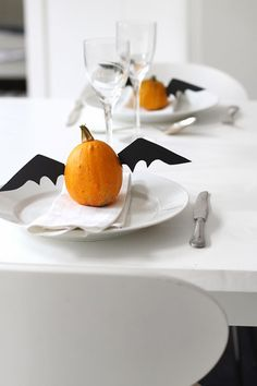 DIY idea for a Halloween party table setting using mini pumpkins