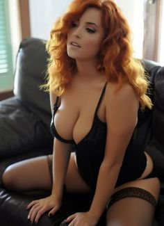 Something is. sexy redhead woman in bed