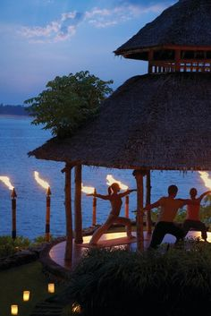 #IgniteTheSpark with hot yoga in an oceanfront pavilion surrounded by torches at @Four Seasons Resorts Bali.