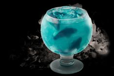 Sugar Factory in New York offers the Ocean Blue, a cocktail in a 60-ounce goblet finished off with gummy sharks for a playful (and vaguely menacing) effect. Photo: Courtesy of Sugar Factory
