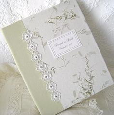 Our Personalized Wedding Photo Album is made of a lovely Wildflower paper with inlaid pedals and vines Embellished with Beaded Lace Flowers & dotted