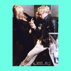 Stormie fixing Ross' hair