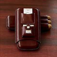 Leather cigar case with silver cutter & lighter